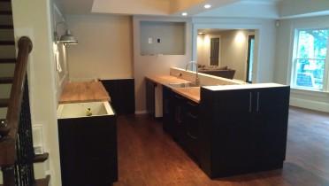 AKURUM Base cabinets with Ramsjö black-brown doors and panels